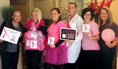 Six Fountains Dental Excellence Team Members posing and smiling to promote breast cancer awareness